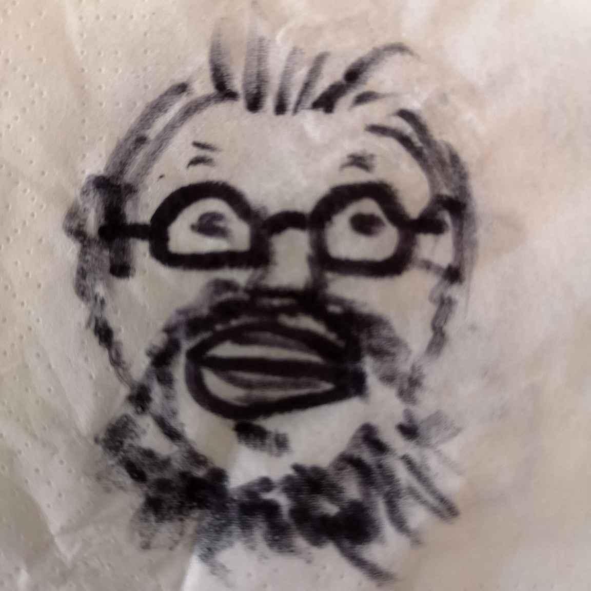 Palkittu taiteilija - omakuva piirrettynä lentokoneessa käsipyyhkeeseen.
